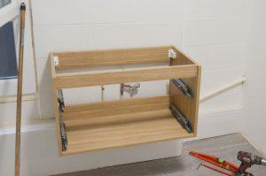 fixation meuble salle bain